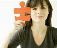 Woman Holding Jigsaw Piece