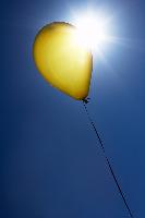 yellow balloon in the sunshine