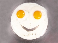fried egg with cut-out smile