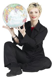 Woman holding a world globe and smiling