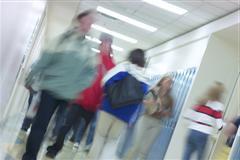 Blurred photo of students in school corridor